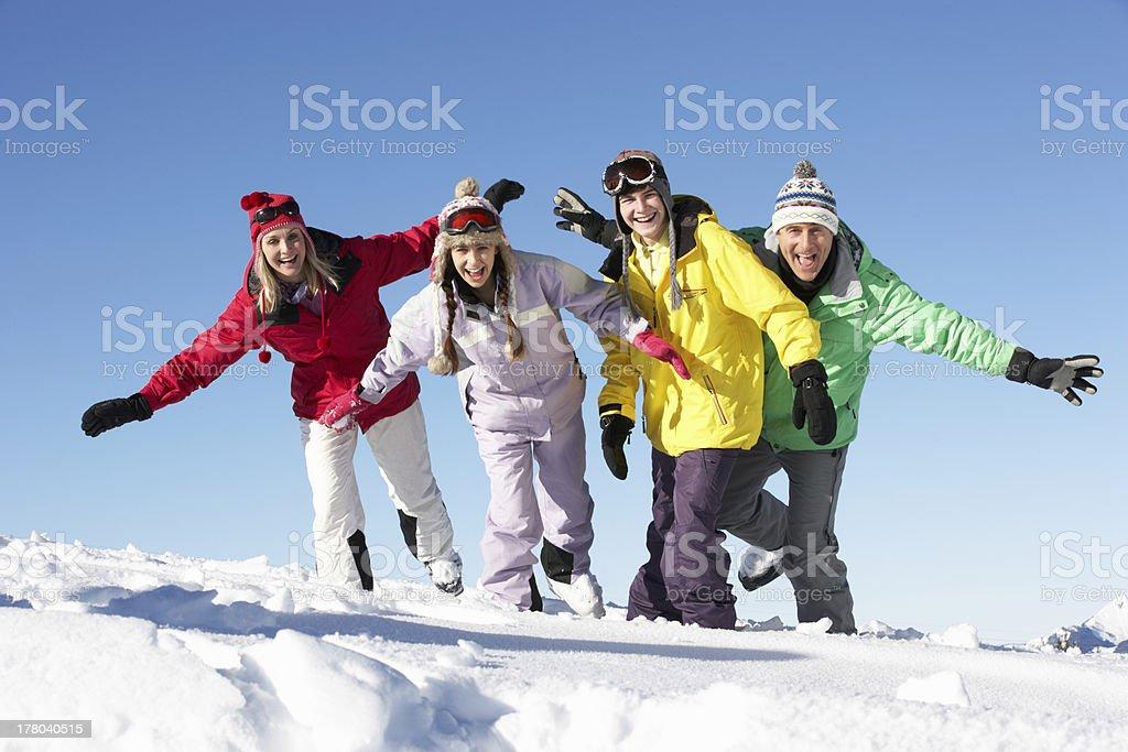 Teenage Family On Ski Holiday In Mountains stock photo