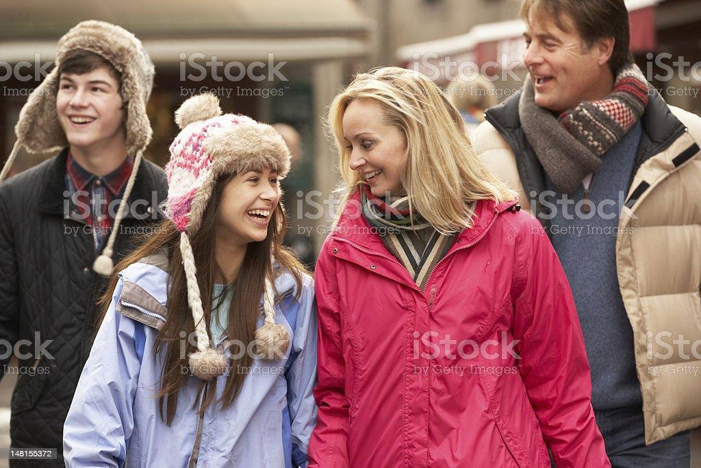 Teenage Family Walking Along Snowy Town Street In Ski Resort royalty-free stock photo