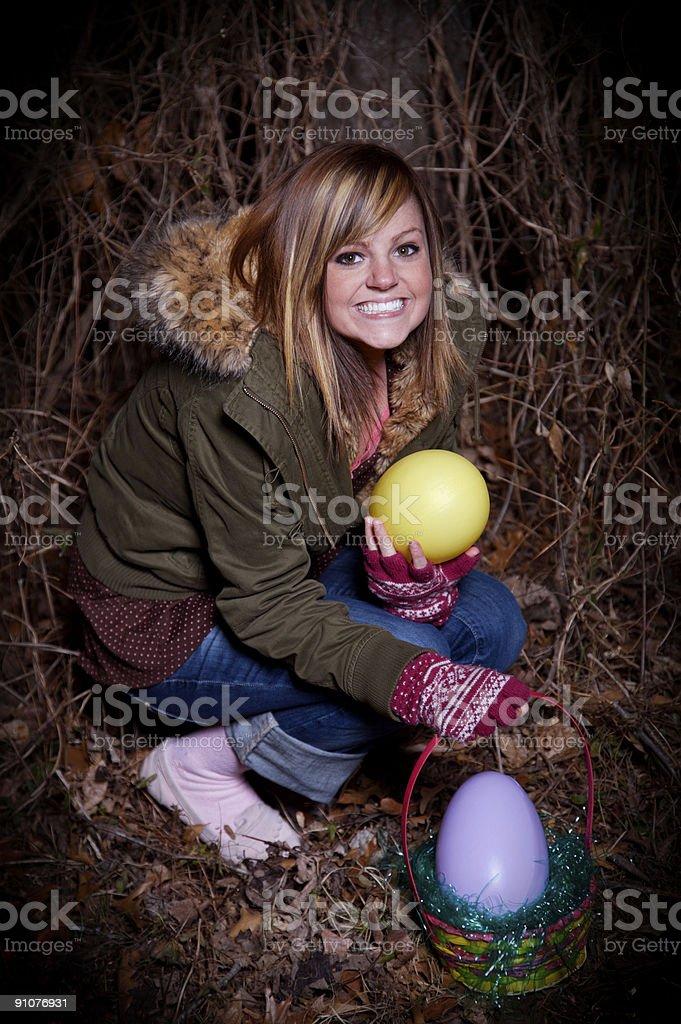 teenage female easter egg hunt stock photo