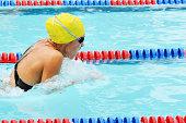 Teenage Female Girl Breaststroke Swimmer Racing in Pool