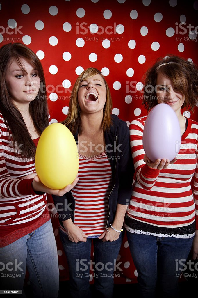 teenage females colored easter eggs stock photo