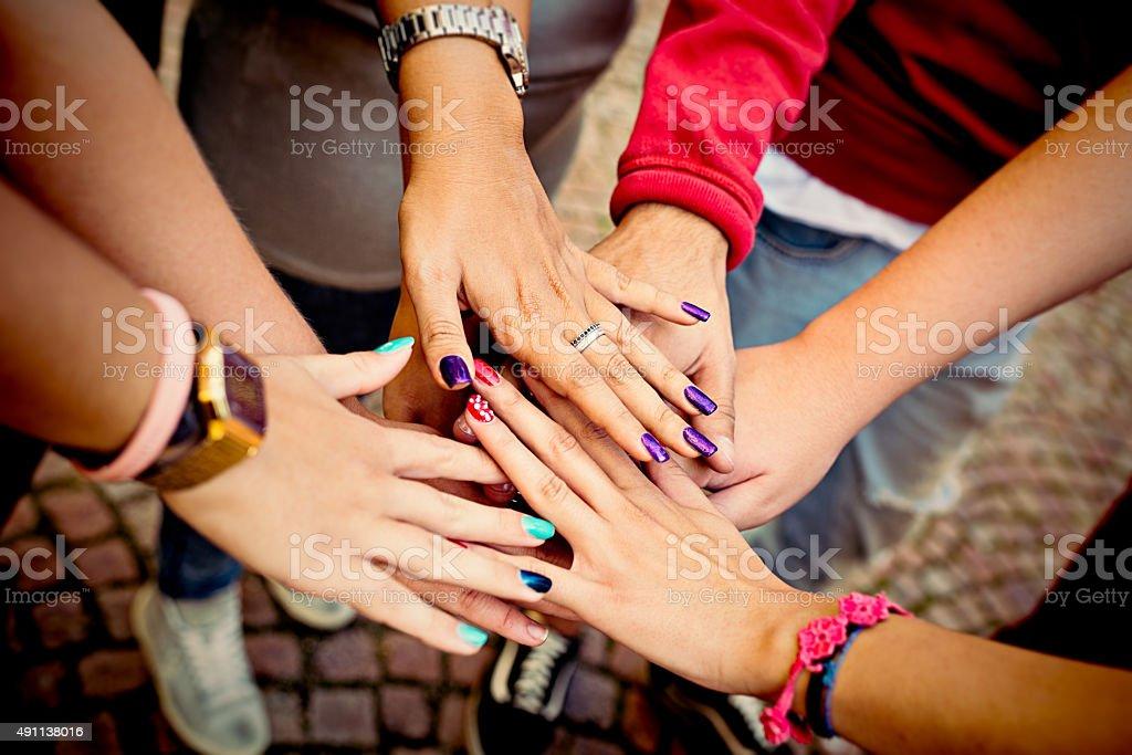 Teenage friendly hand stock photo