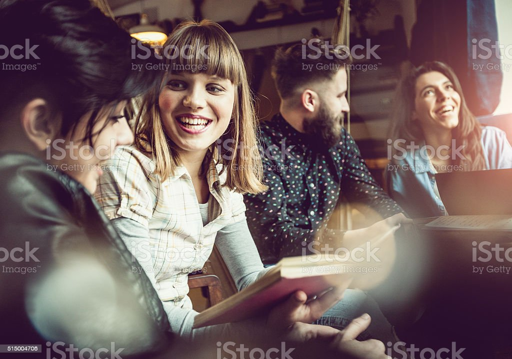 Teenage friends at the coffee bar stock photo