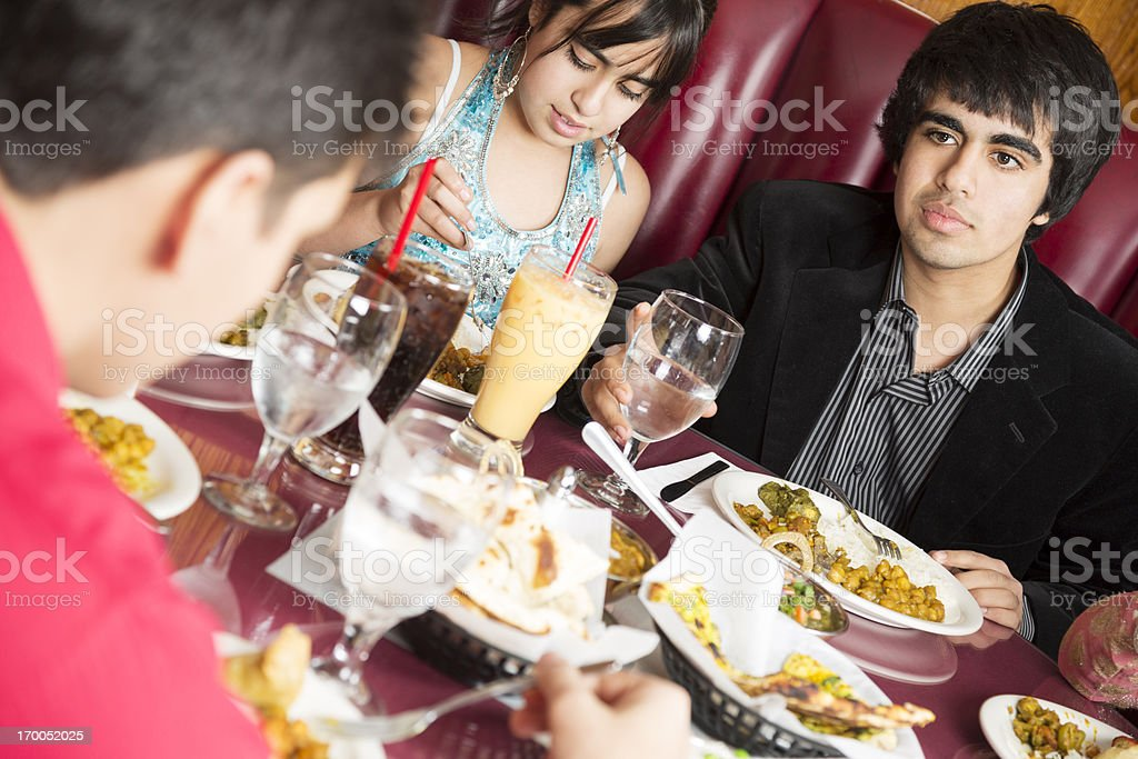 Teenage friends eating lunch at the indian restaurant royalty-free stock photo