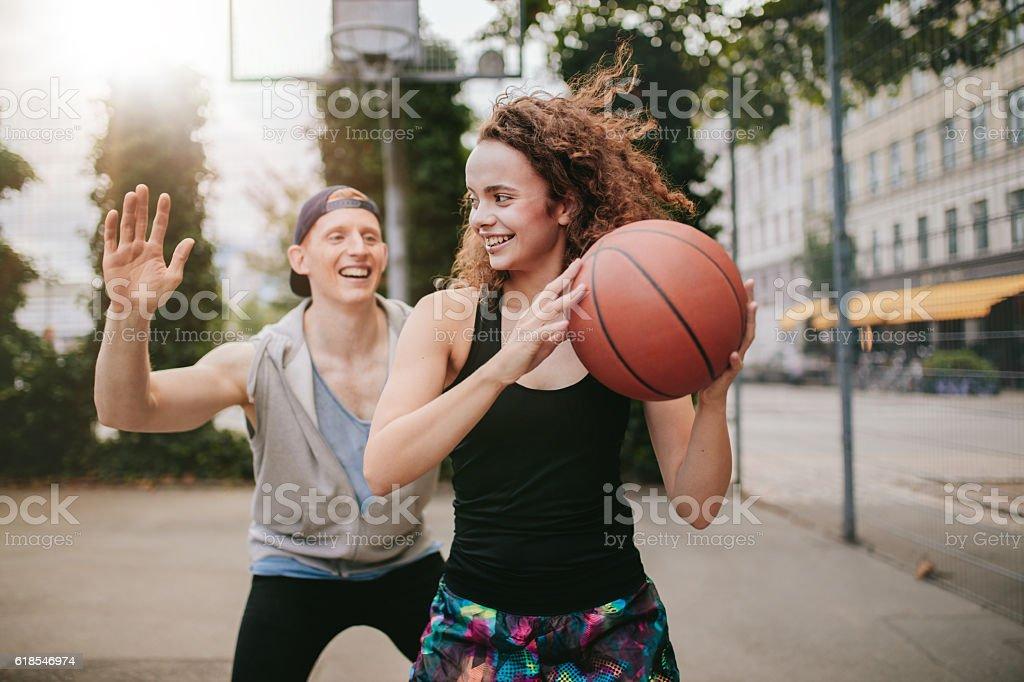Teenage friends enjoying a game of streetball stock photo