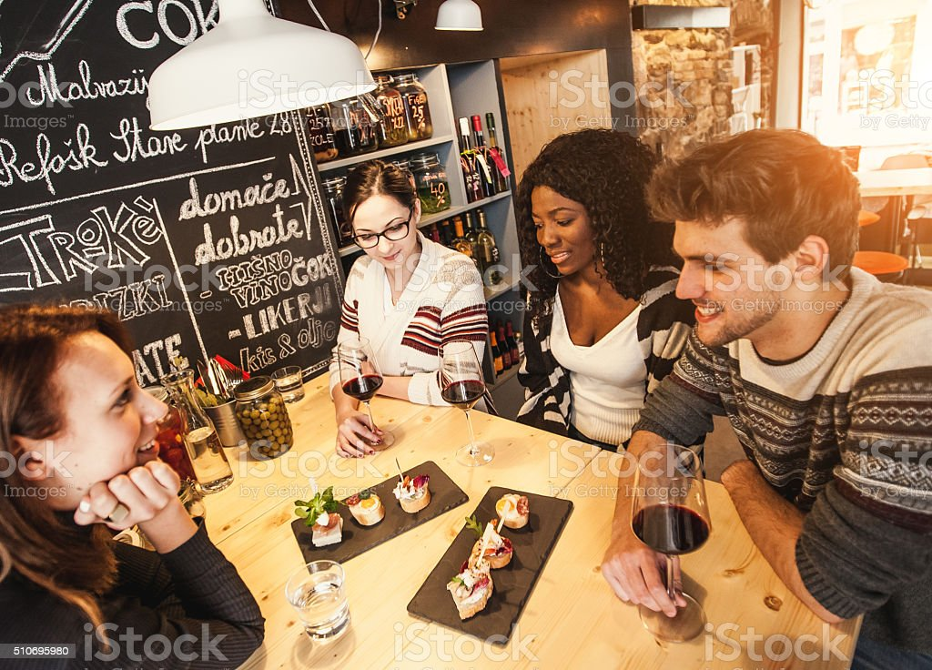 Teenage friends having fun at the coffee shop stock photo