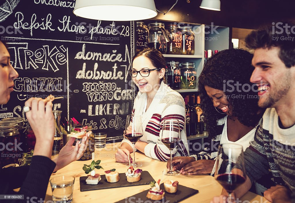 Teenage friends having fun at the snack bar stock photo