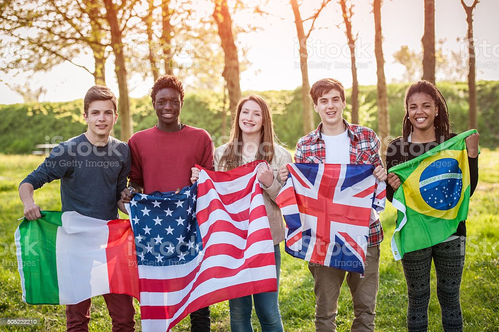 Teenage Friends Holding Flags from different Countries stock photo