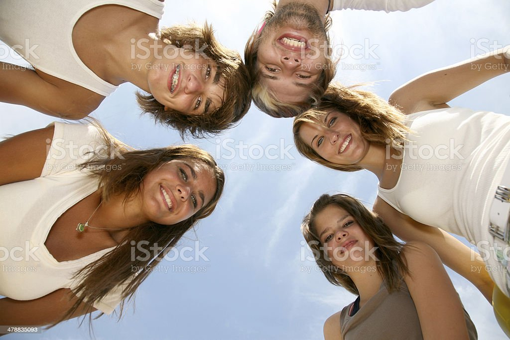 Teenage Friends in a Circle with the Sky as Backdrop royalty-free stock photo