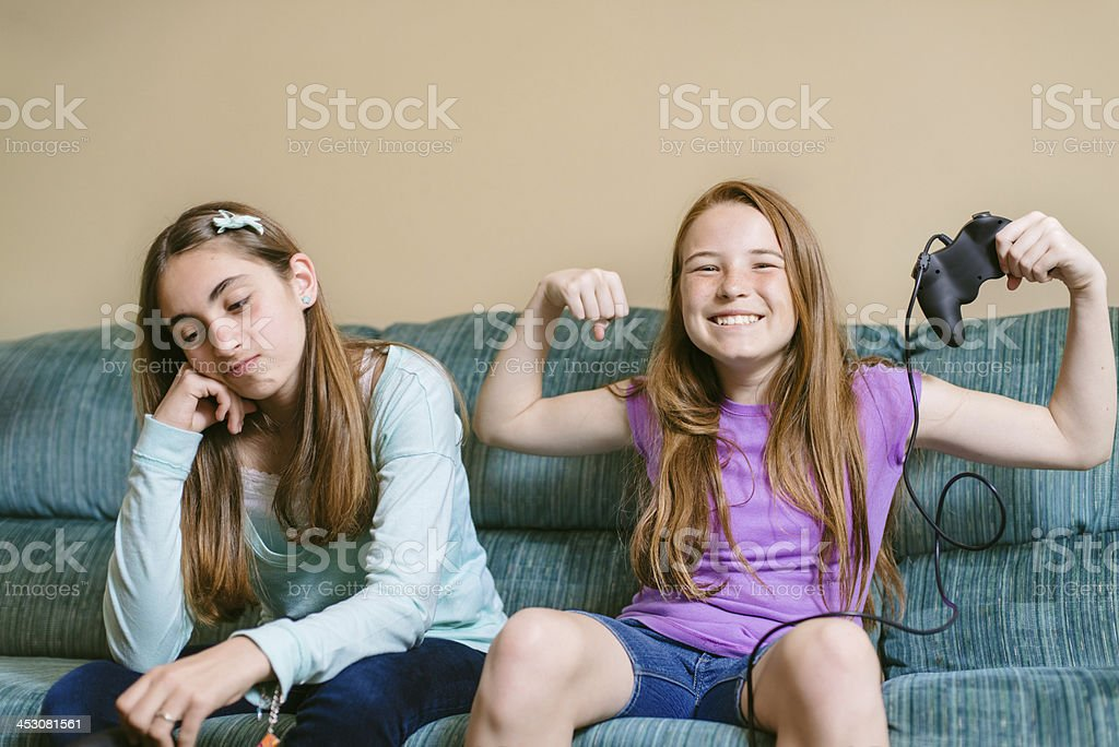 Teenage friends playing video games royalty-free stock photo