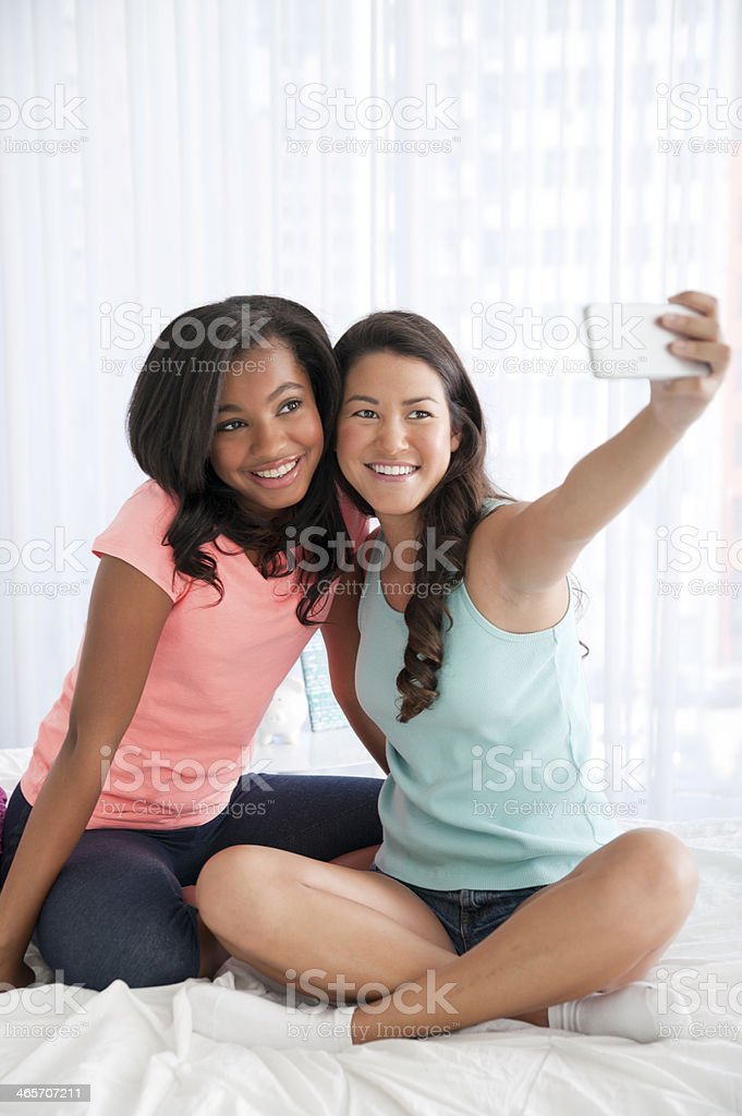 Teenage friends taking a photo royalty-free stock photo
