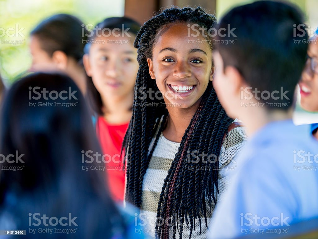 Teenage Friends Talking Between Class stock photo