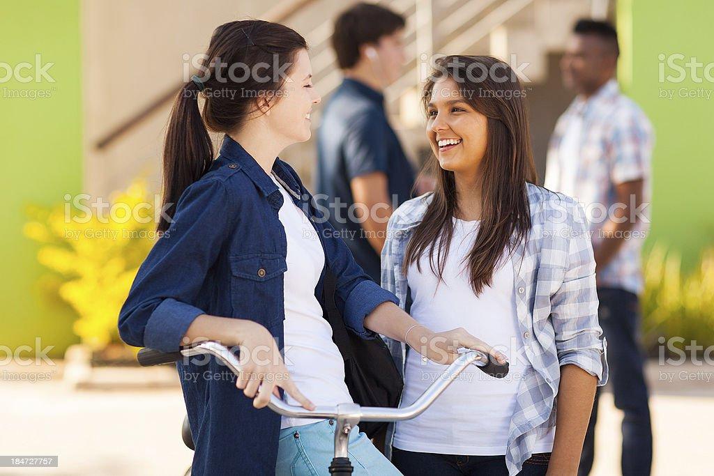 teenage friends talking outdoors royalty-free stock photo