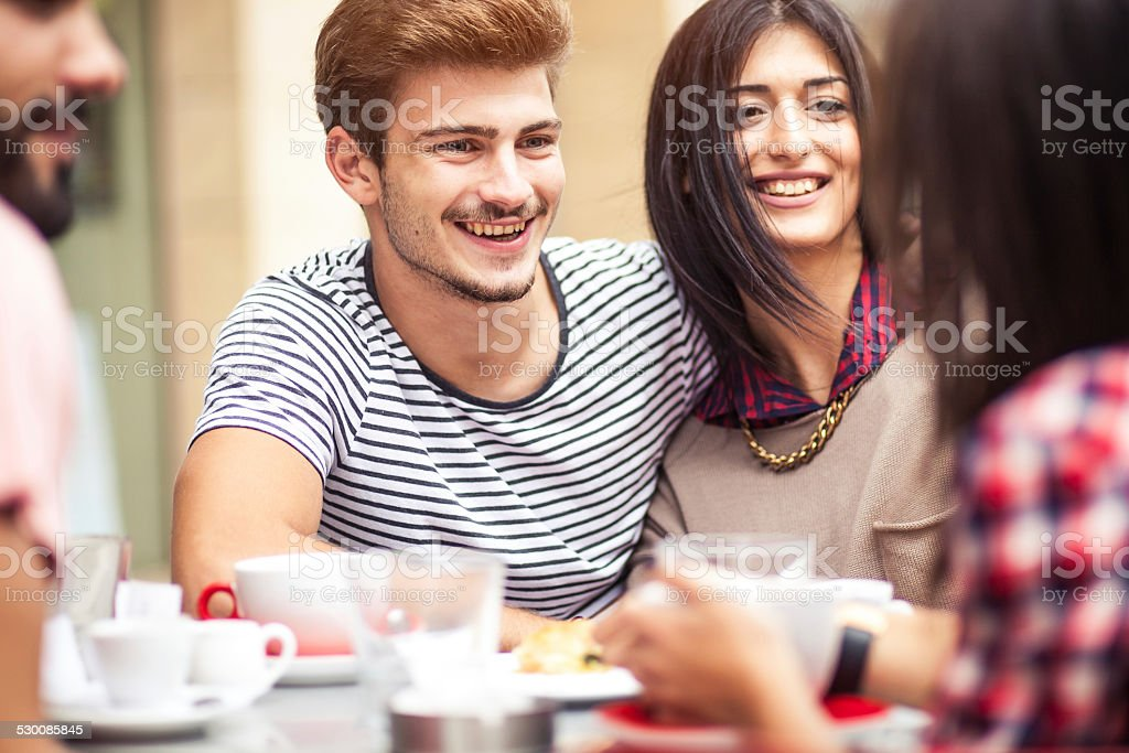 Teenage friends together at the coffee bar stock photo