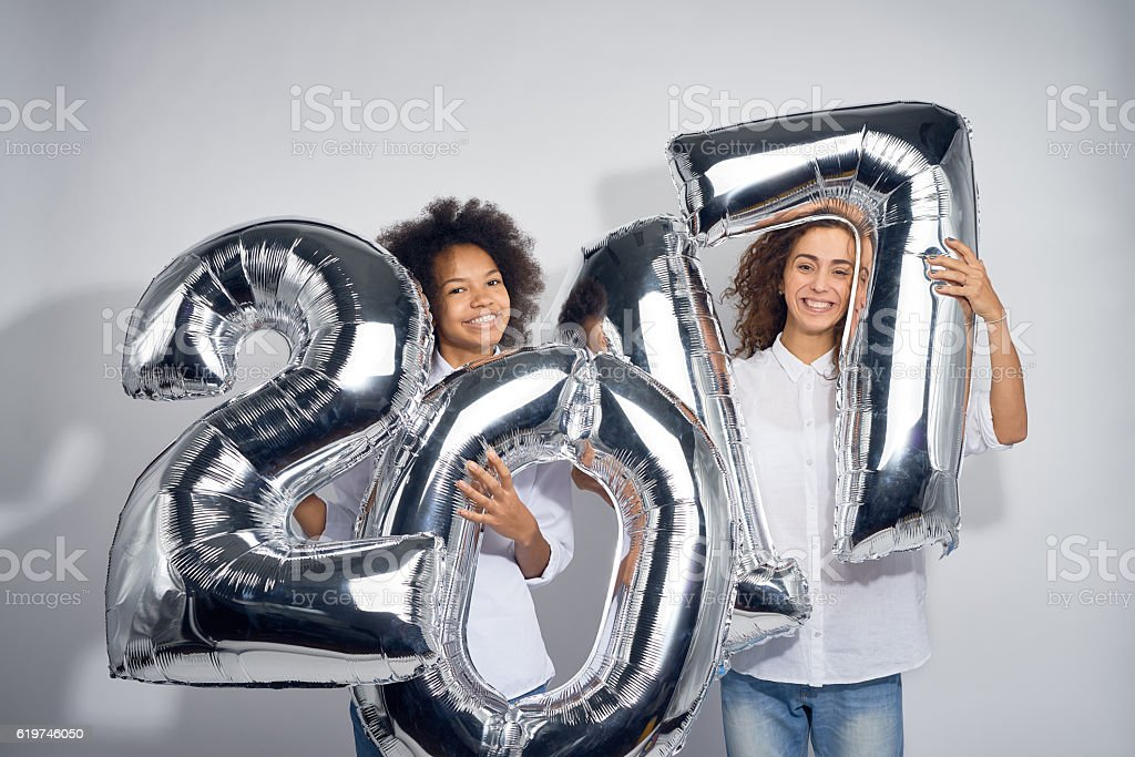 Teenage Friends With 2017 Air Balloons stock photo