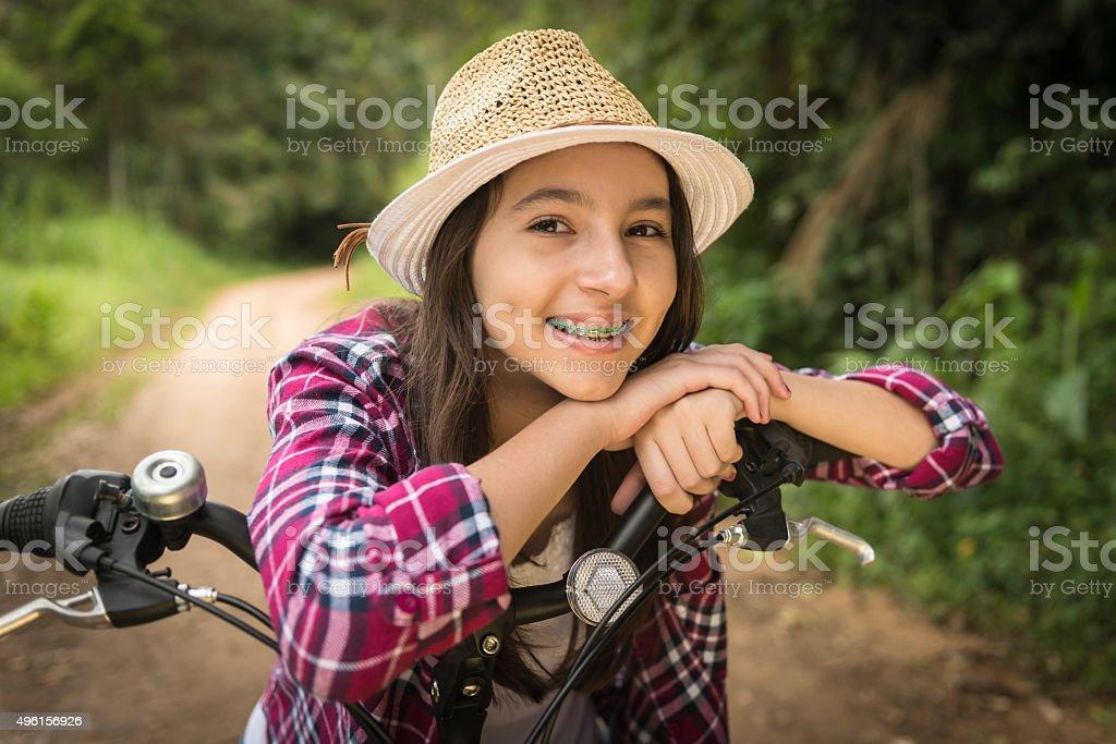 Teenage girl and bicycle stock photo