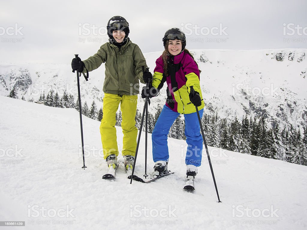 Teenage girl and boy skiing royalty-free stock photo