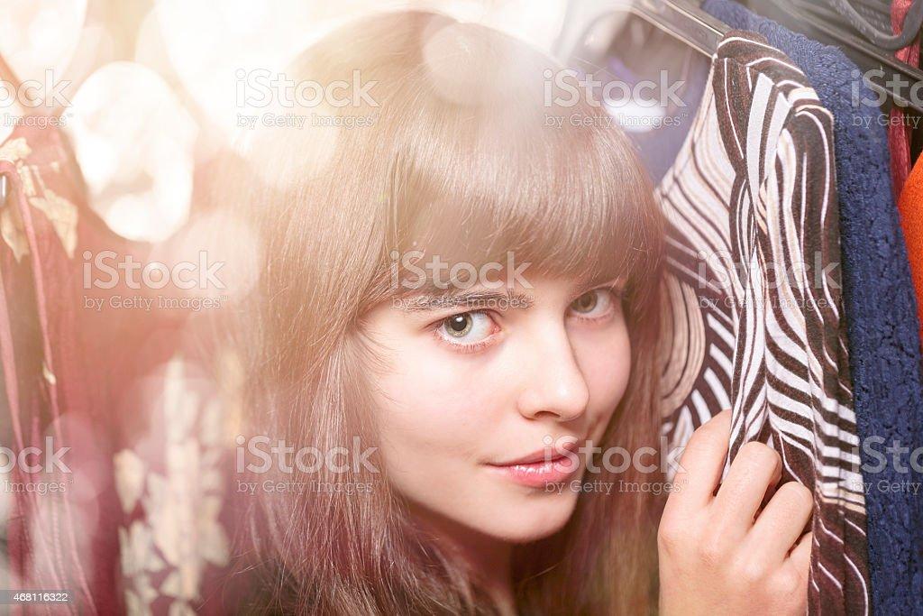 teenage girl and her wardrobe, with bokeh stock photo