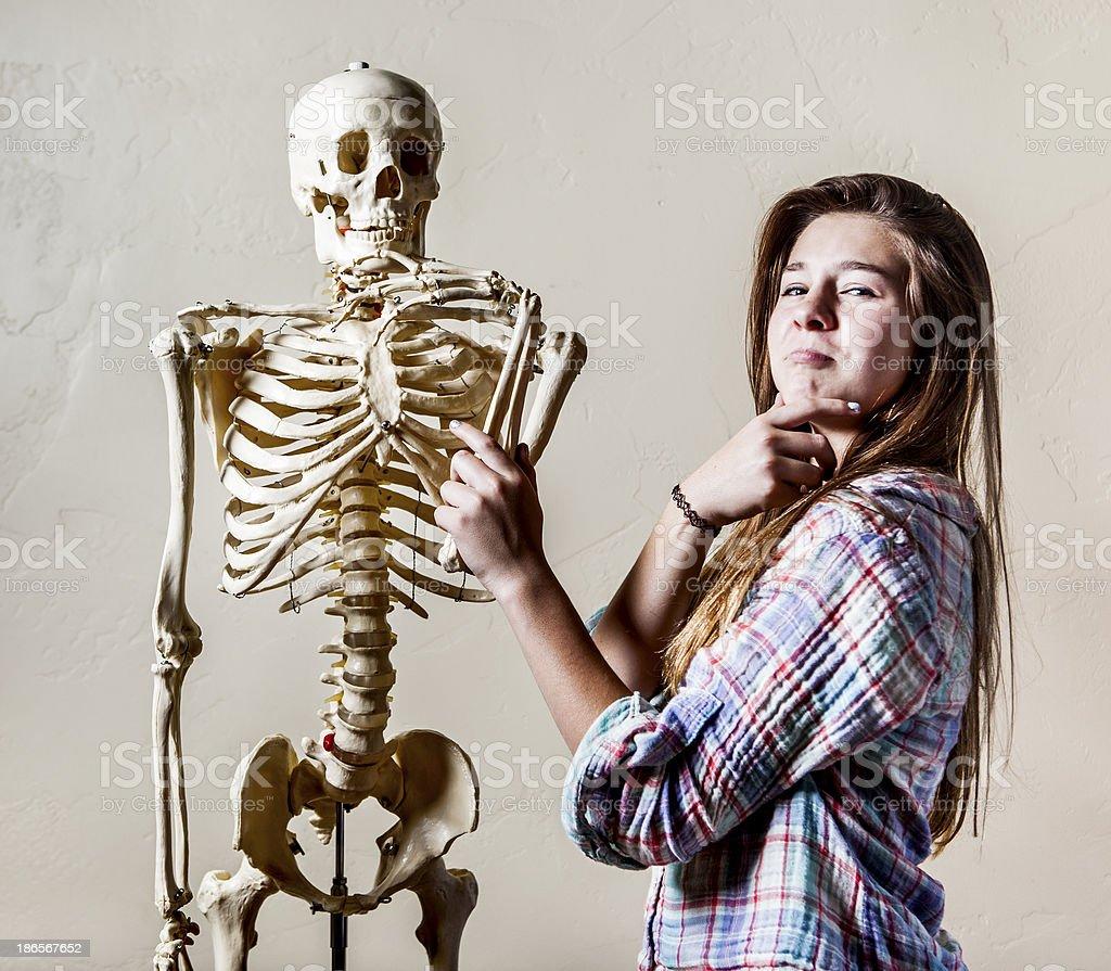 Teenage Girl and Skeleton royalty-free stock photo