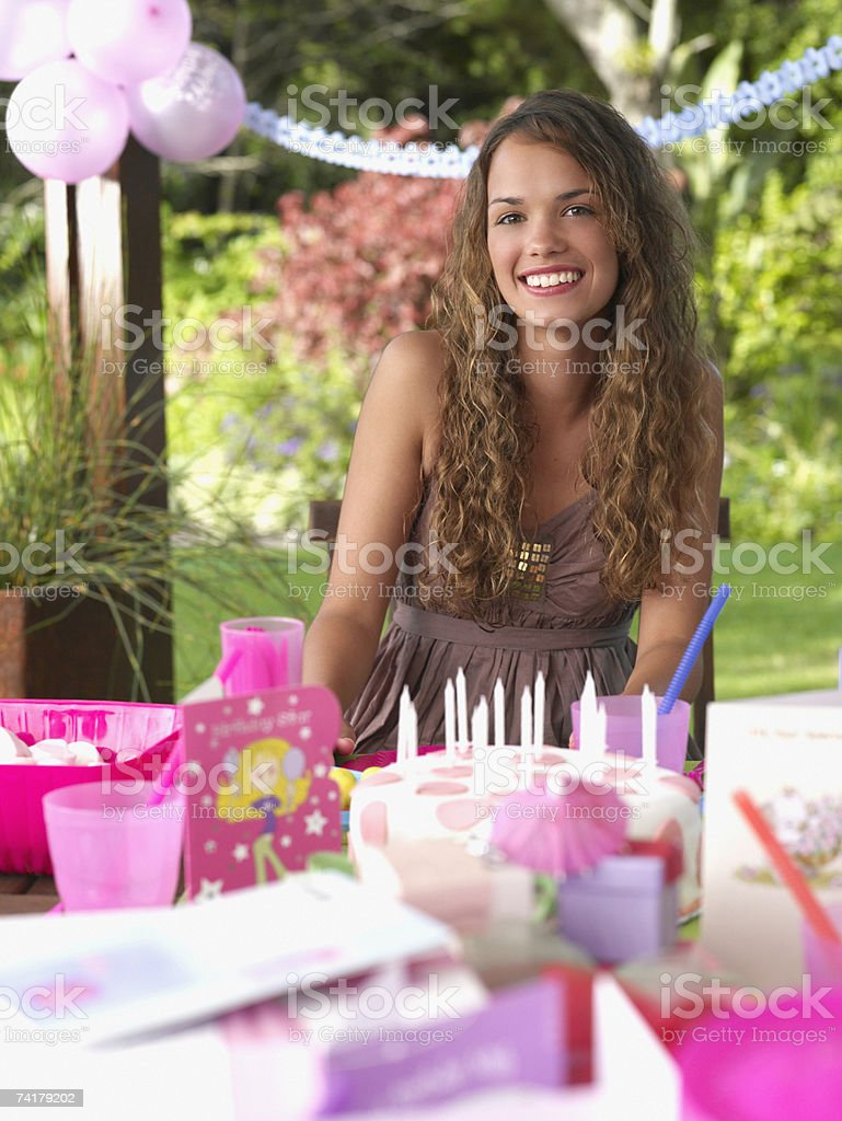 Teenage girl at birthday party smiling outdoors stock photo