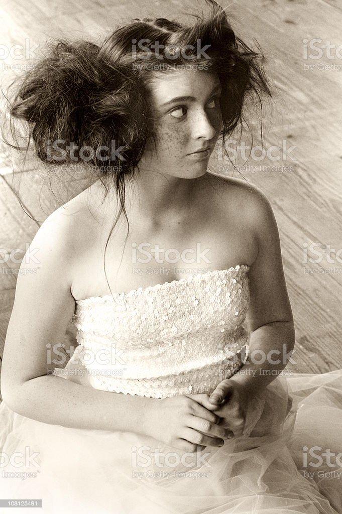 Teenage Girl Ballerina Sitting on Floor, Sepia Toned royalty-free stock photo