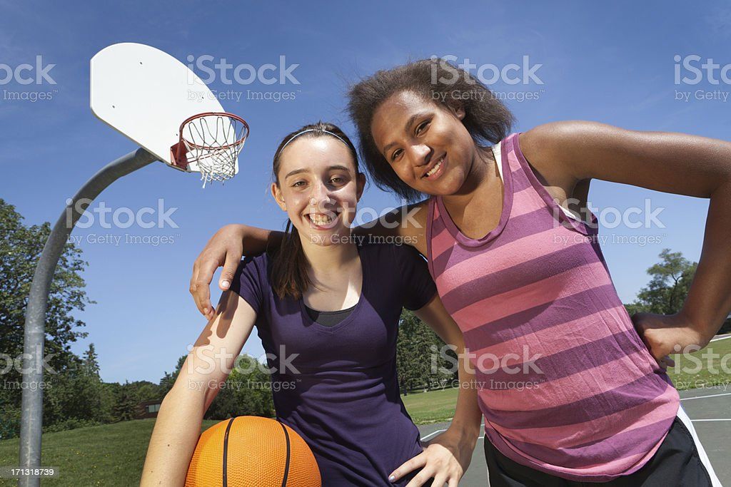Teenage Girl Basketball Players on Outdoor Court, Two Interracial Friends royalty-free stock photo