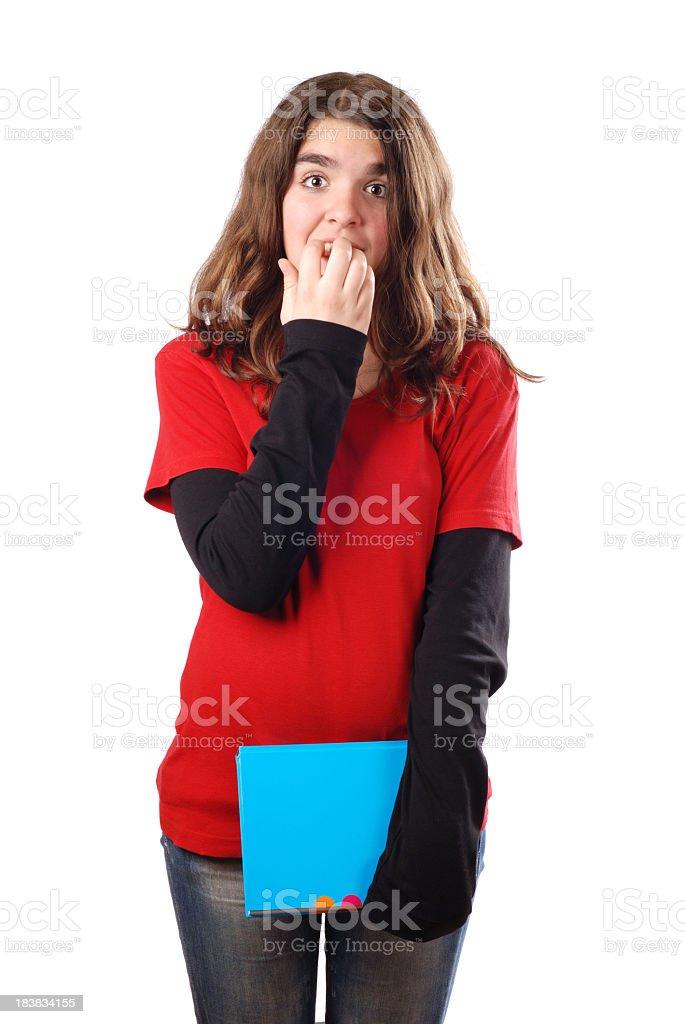 Teenage girl biting nails before exam royalty-free stock photo