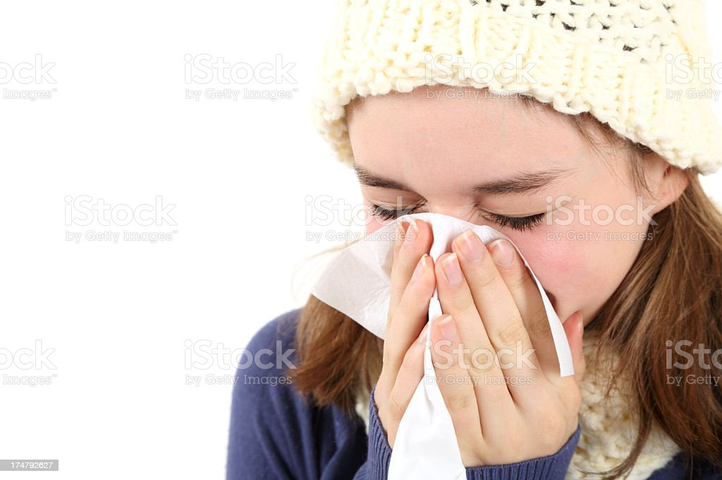 Teenage girl blowing her nose royalty-free stock photo