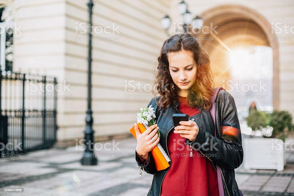 Teenage girl calling for Uber stock photo