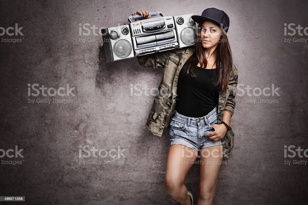 Teenage girl carrying a ghetto blaster stock photo
