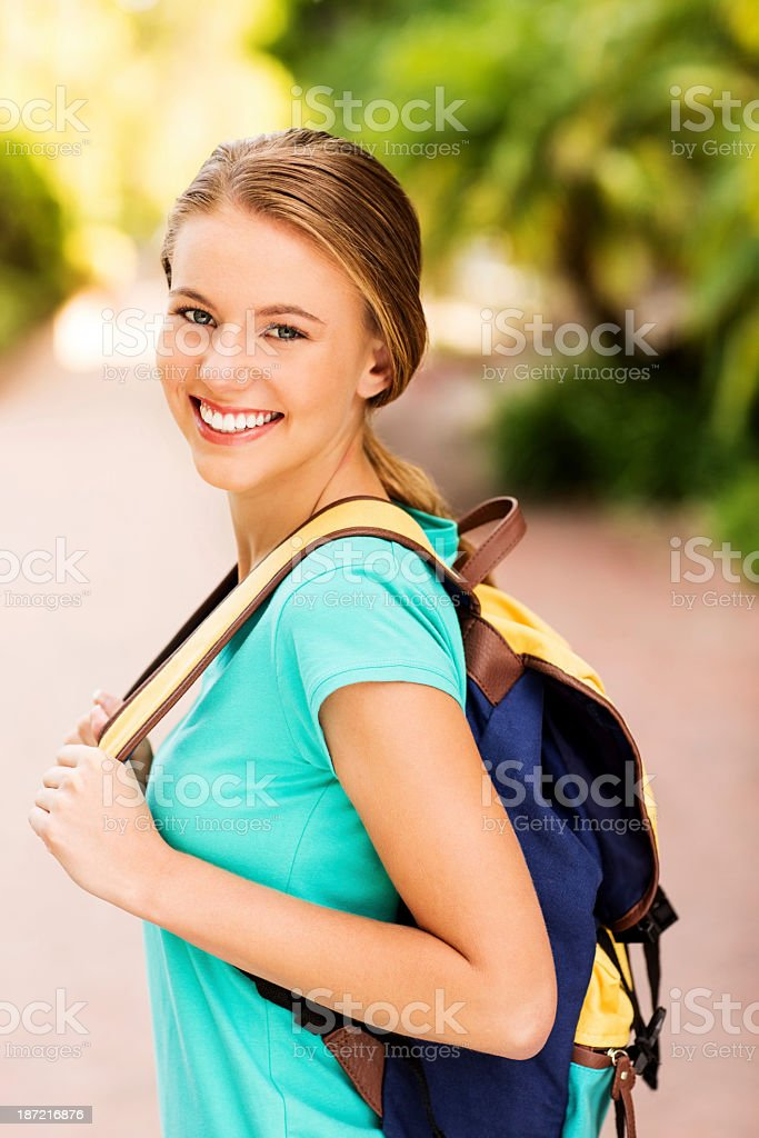 Teenage Girl Carrying Backpack On College Campus royalty-free stock photo