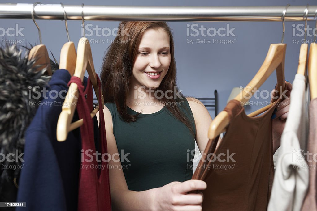 Teenage Girl Choosing Outfit From Wardrobe royalty-free stock photo