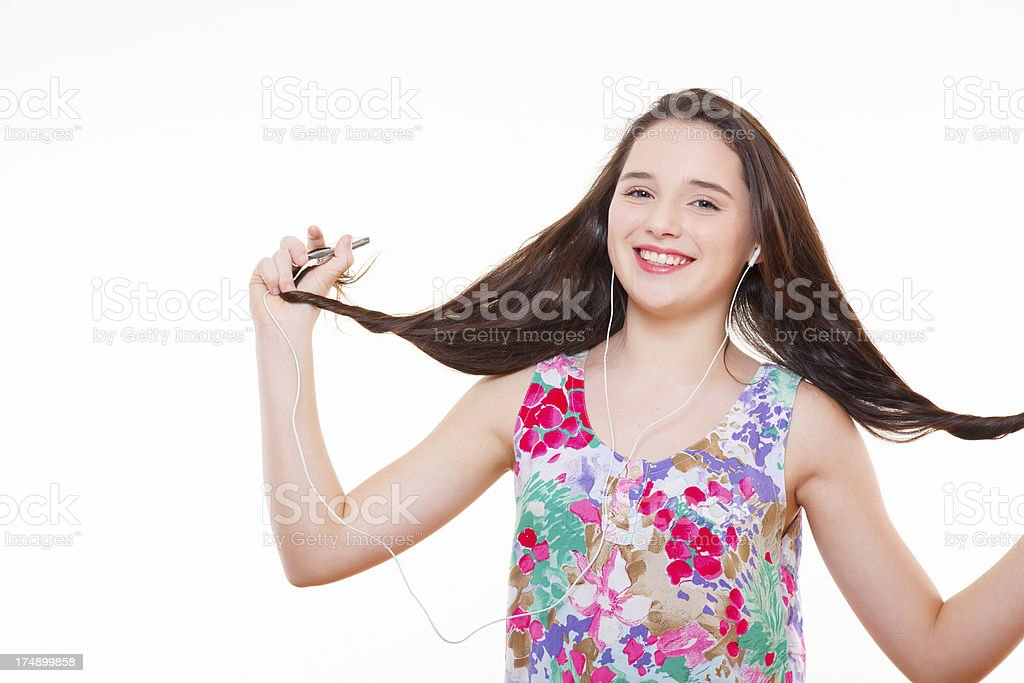 Teenage girl dancing and listening to mp3 player royalty-free stock photo