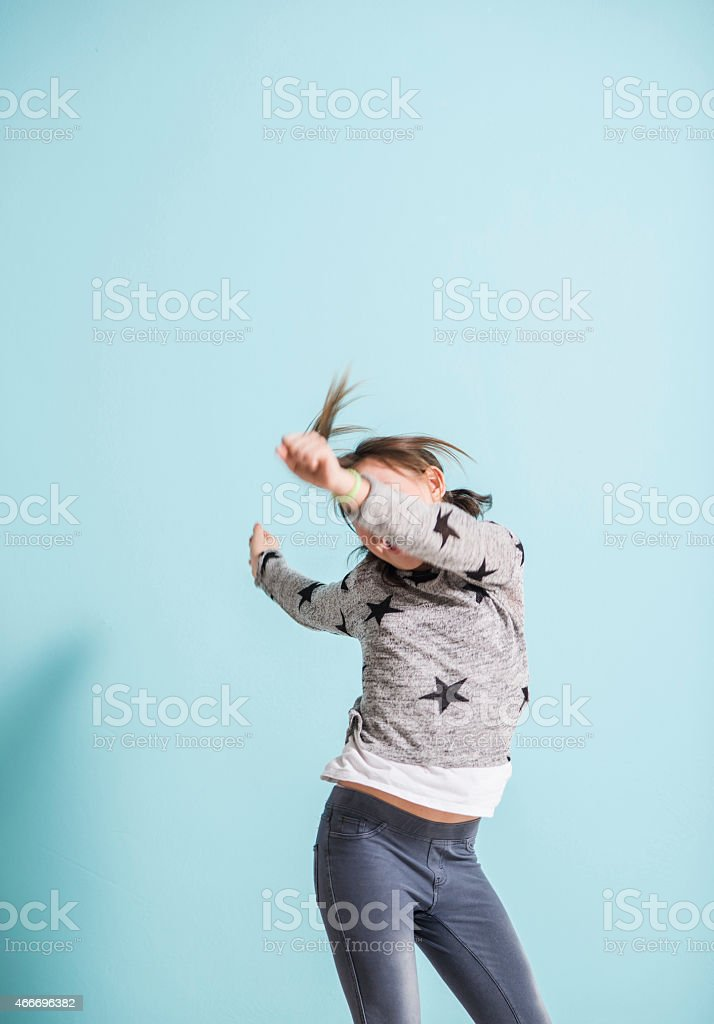 Teenage girl dancing in studio stock photo