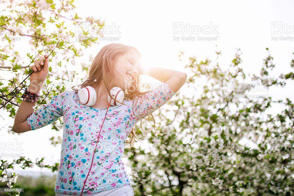 Teenage girl daydreaming in the park stock photo