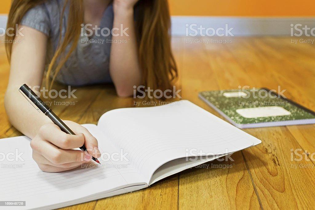 Teenage girl doing homework royalty-free stock photo