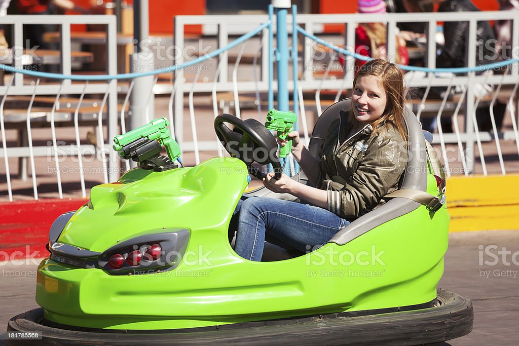 Teenage girl driving a bumper car royalty-free stock photo