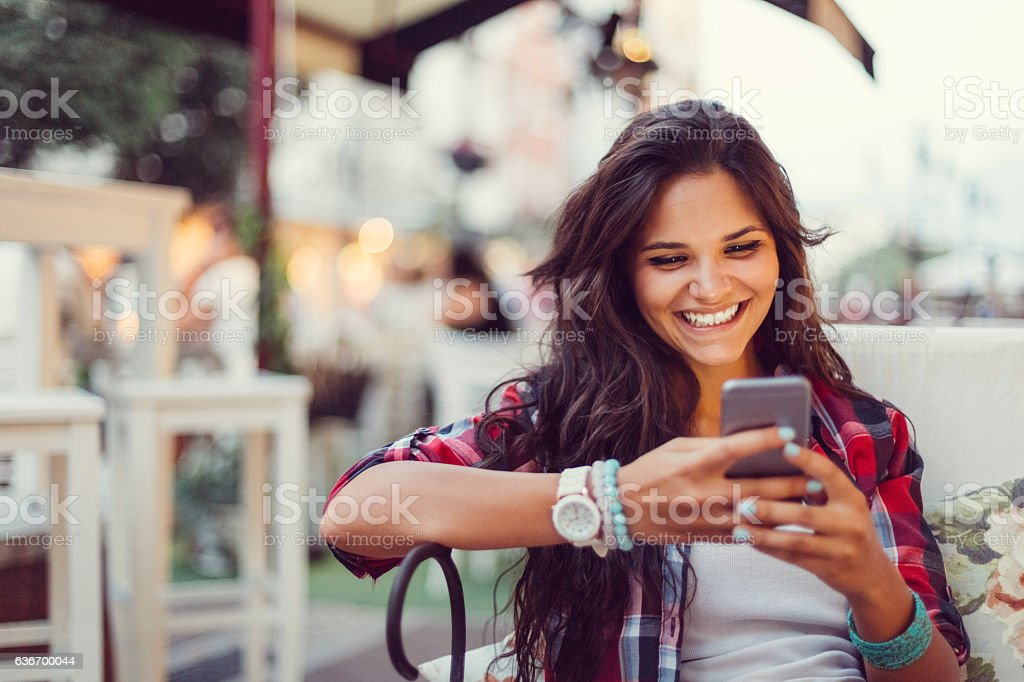 Teenage girl enjoying an online dating stock photo
