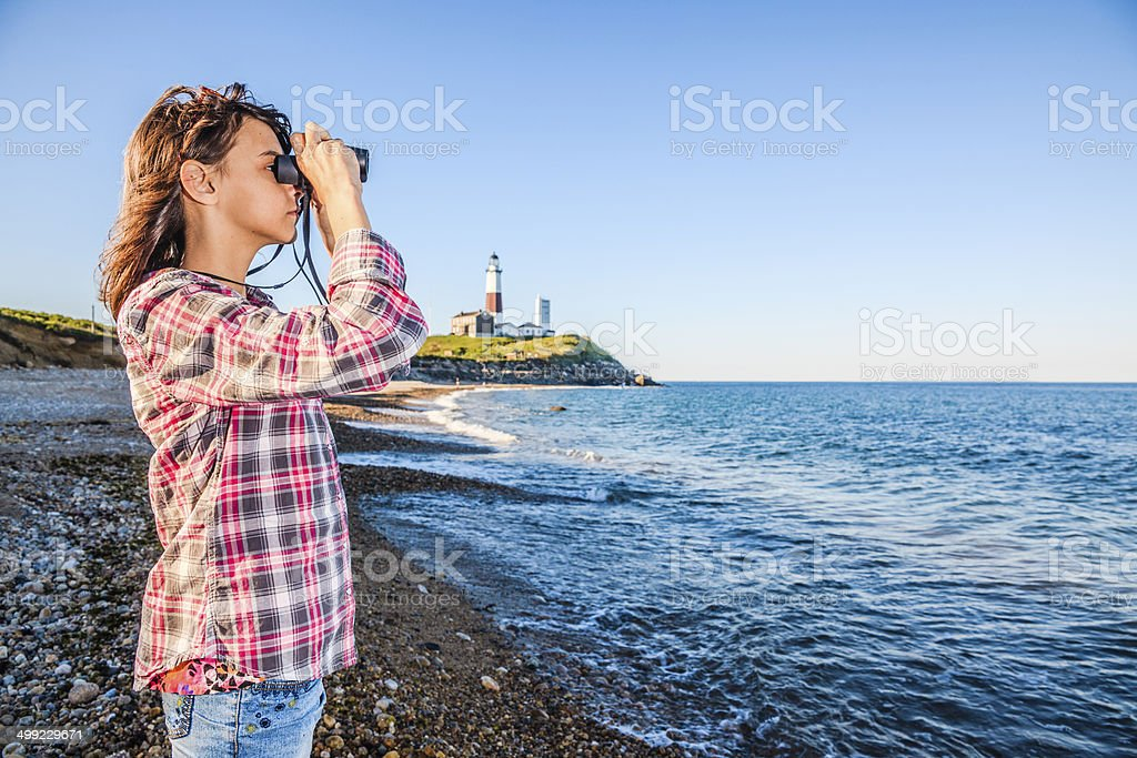 Teenage girl exploring ocean with binocular royalty-free stock photo