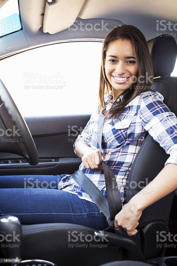 Teenage Girl Fastening Seat Belt In Car royalty-free stock photo