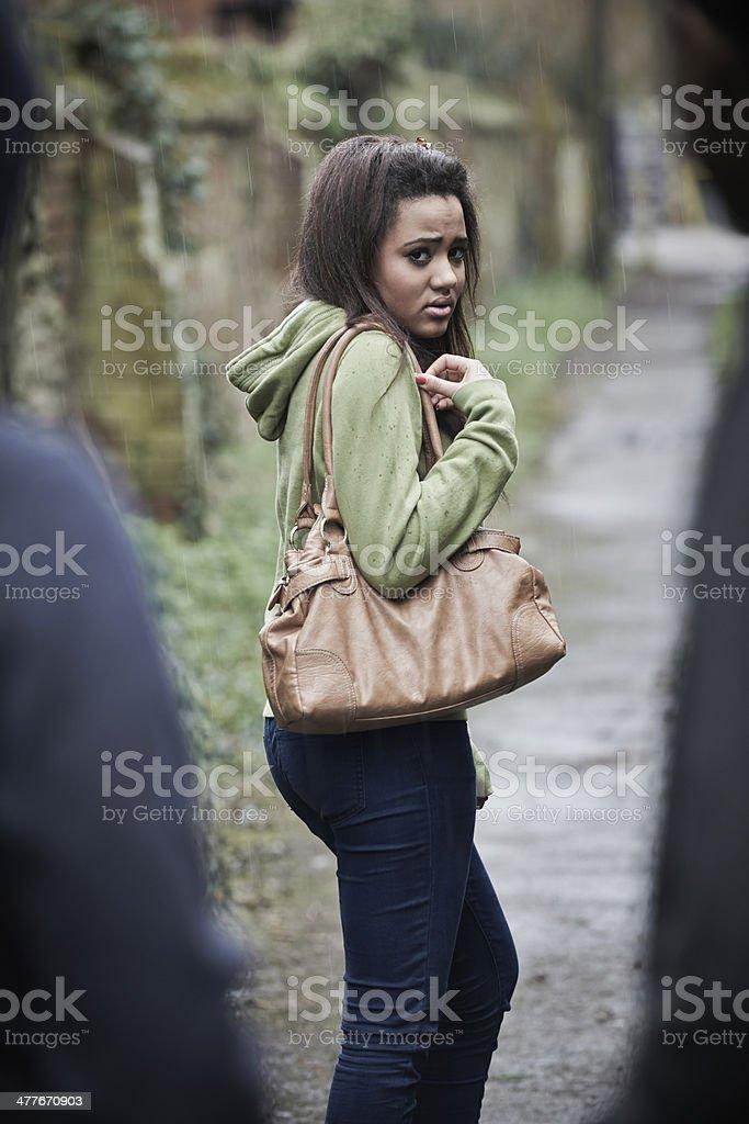 Teenage Girl Feeling Intimidated As She Walks Home stock photo