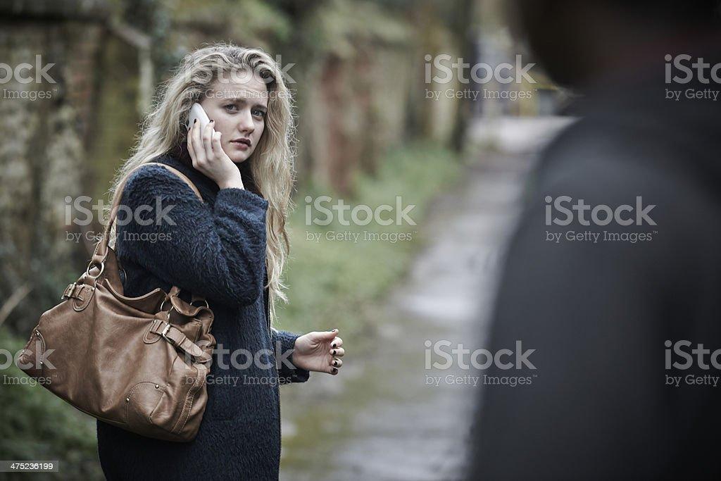 Teenage Girl Feeling Threatened As She Walks Along Path stock photo