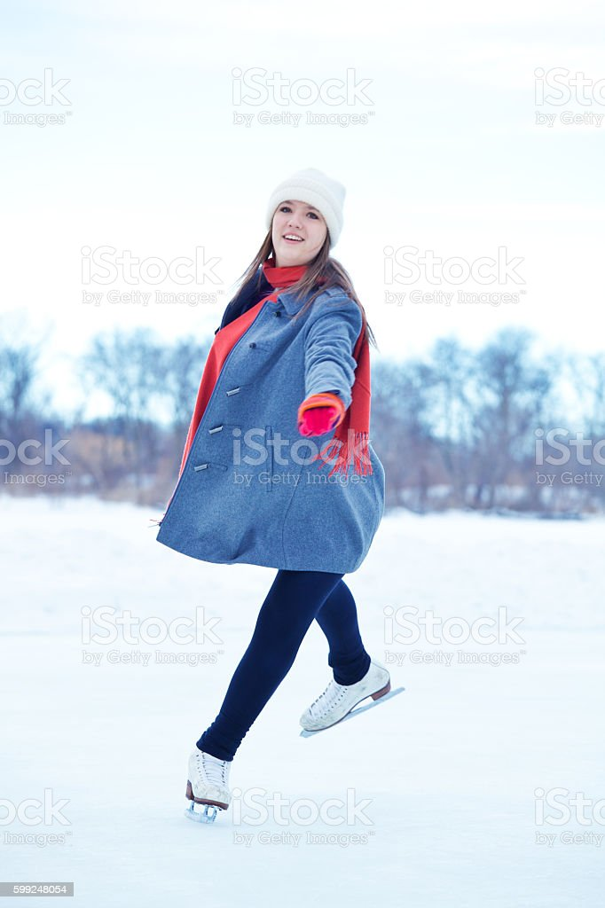 Teenage Girl Figure Skating on Winter Lake Ice Rink, Minneapolis stock photo