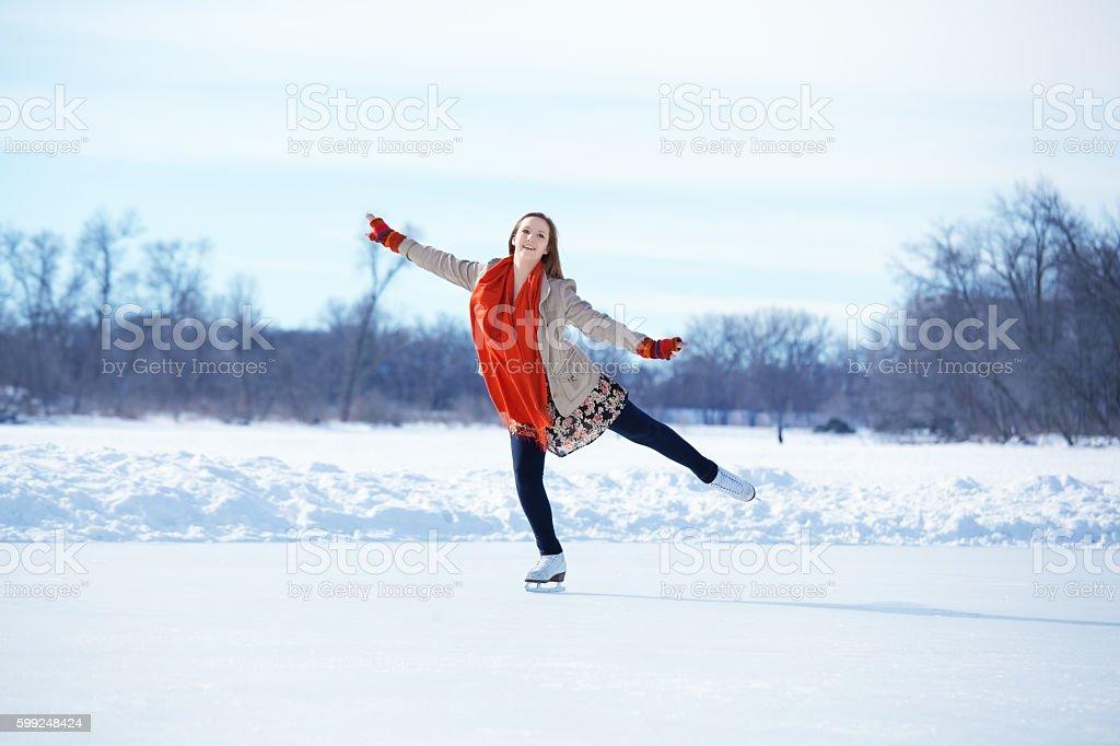 Teenage Girl Figure Skating on Winter Lake Ice Rink, Minneapolis stock photo