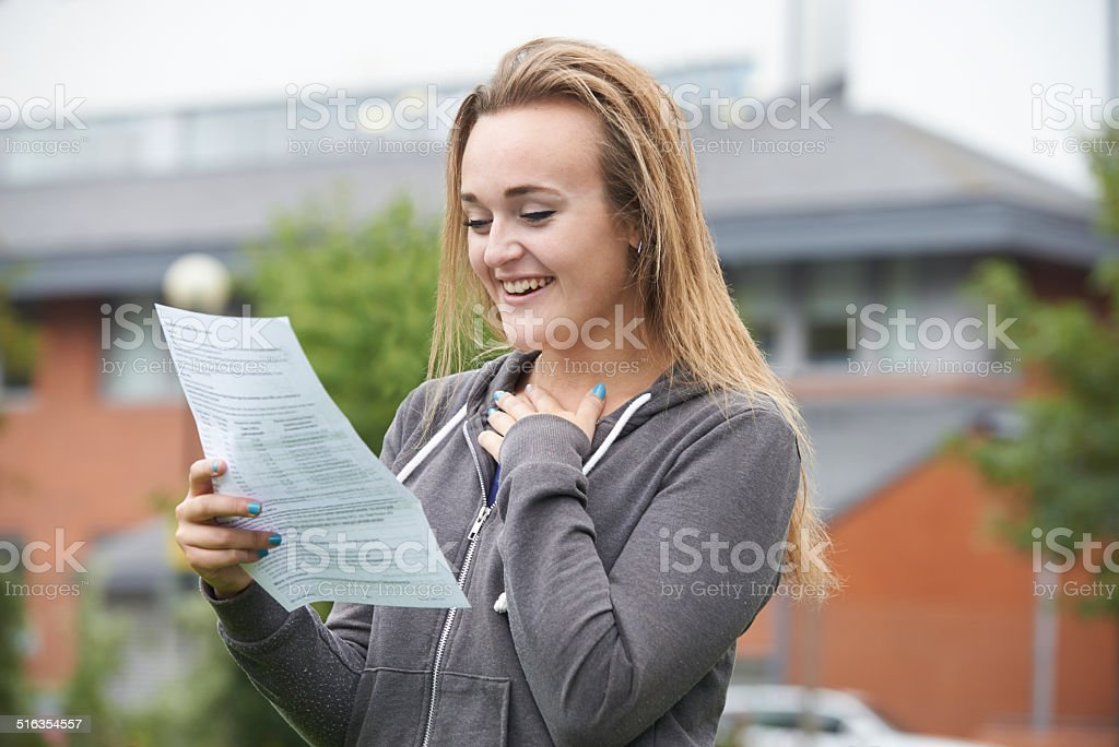 Teenage Girl Happy With Good Exam Results stock photo