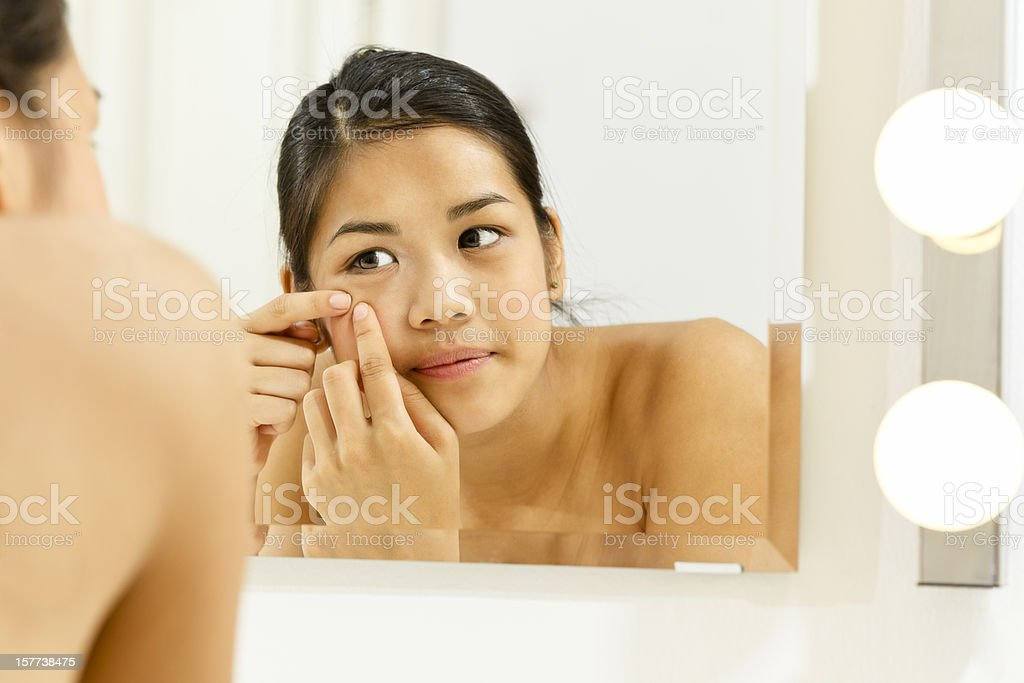 Teenage girl having problems with pimples royalty-free stock photo