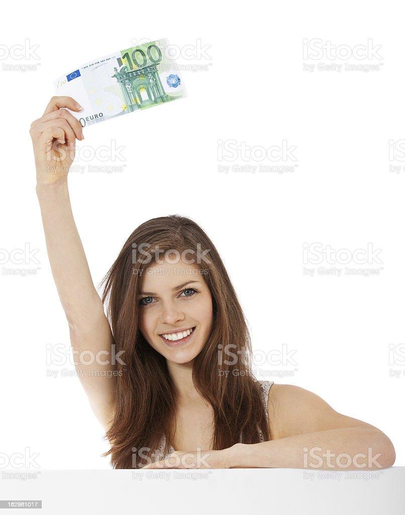 Teenage girl holding 100 euro note stock photo
