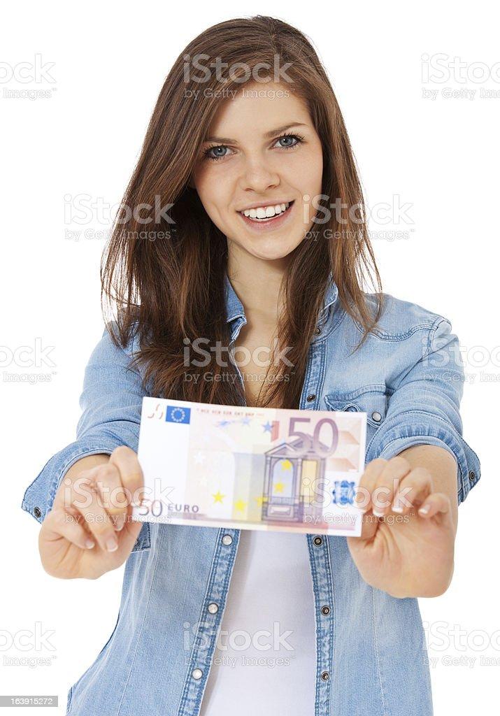Teenage girl holding 50 euro note royalty-free stock photo