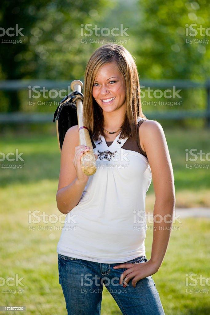 Teenage Girl Holding a Baseball Bat and Glove stock photo
