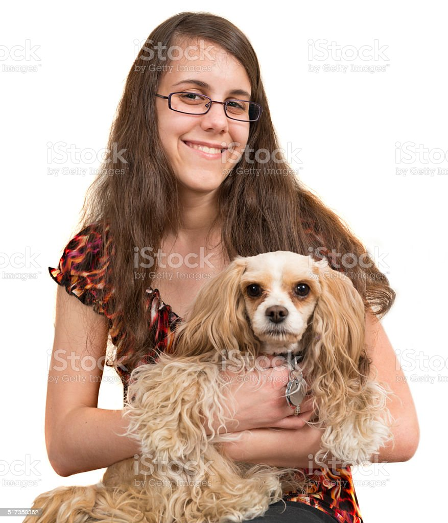 Teenage girl holding a designer dog stock photo
